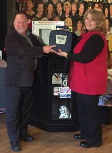 Robert Mack presents an AED to Naima Kradjian at The Goodwill Theatre/Schorr Family Firehouse Stage